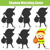 Shadow matching game. Kids activity with Christmas elf. New year theme fun page for toddlers stock photos
