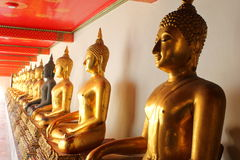 Shadow of the meditation buddha statues in buddhist temple wat pho, bangkok, Stock Photo