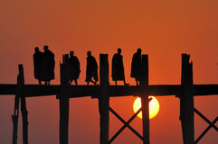Shadow of monks. Shadow of the monks on wooden bridge Stock Photography