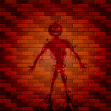 Shadow of monster on a brick wall Stock Images