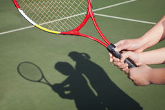 Shadow of mother and daughter playing tennis Royalty Free Stock Photo
