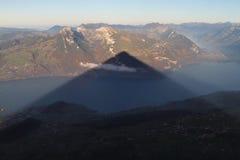 Niesen. Shadow of Mountain Niesen in Switzerland stock images