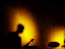 Shadow music concert. Rock music concert. Concert on wall. Musician playing music royalty free stock images