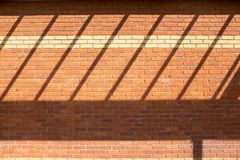 Shadow on new red brick wall Stock Images