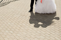Shadow of the newly-married couple on the earth. Stock Photo