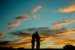 Shadow of Nice couple stand on the mountain before sunset Royalty Free Stock Photos