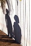 Shadow Of A Boy With Mother At A Wooden Fence Royalty Free Stock Image