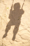 Shadow Of Child In Swing Stock Photo