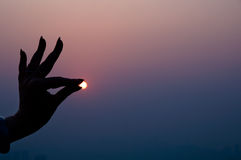 Shadow Of Hand In Sunset Royalty Free Stock Photography