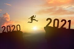 Shadow Of Man Jump From 2020 To 2021 Year Stock Photos