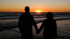 shadow old couple with a sunset background royalty free stock photo