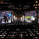 Shadow pattern under elevated train tracks Stock Photo