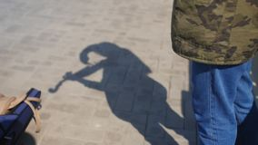 Shadow on the pavement of young girl plays the violin on the promenade for tourists in the summer. Close up shot. Shadow on the pavement of young girl plays the stock video footage