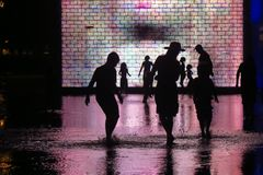 Shadow of people playing. Shadow of a people playing at the water attraction in the millenium park. Chicago Royalty Free Stock Photos