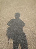 Shadow people on the road. Background Stock Images