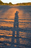 Shadow of person on a field Royalty Free Stock Photography