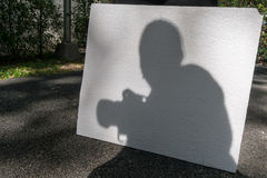 Shadow of a photographer holding camera Stock Photography