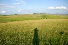 Shadow of the photographer on a mountain meadow Stock Photo