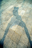 Shadow with photographer. Shadow of photographer on stone floor Royalty Free Stock Photo