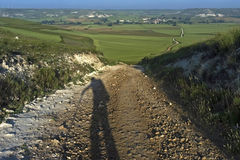 Shadow pilgrim, rural landscape, Camino Frances Royalty Free Stock Images