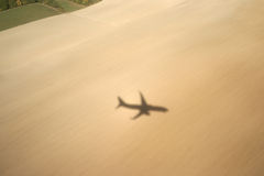 Shadow of a plane on a field Stock Photography