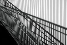 Shadow play. Hand railing & wall Stock Photos