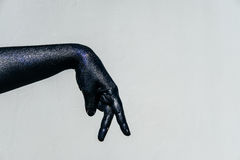 Shadow play Black Hand of death with Sparkles on a gray backgrou Royalty Free Stock Photography
