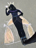 Shadow princess on asphalt. Shadow princess in the crown on asphalt Stock Photo
