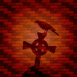 Shadow of raven and cross on a brick wall Royalty Free Stock Images