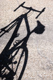 Shadow of a road bike on streen pavement Royalty Free Stock Image