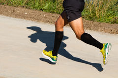 Shadow of a runner Royalty Free Stock Photos