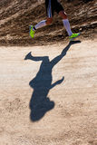 Shadow of a runner Royalty Free Stock Images