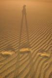 Shadow on the sand dunes Stock Photos