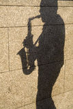 Shadow of saxophone player Royalty Free Stock Photos