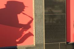 Shadow of Saxophone Player royalty free stock photography