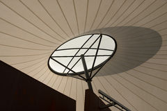 Shadow On shade Sail. A shadow thrown across the shade sail above a stage Stock Image