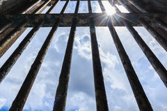 Shadow shining through the bars of the old prison stock photography