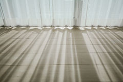 Shadow from shining through a window and the curtains Stock Image