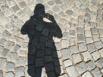 Shadow of shooting man Royalty Free Stock Photography