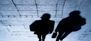 Shadow silhouette of travellers in the night stock photo