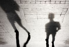 Shadow silhouette of two people Stock Photos