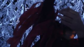 Shadow silhouette of young man wandering in snowy winter forest at silent night. stock video