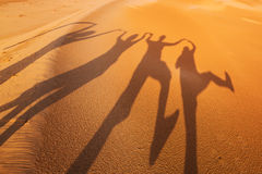 Shadow silhouettes of four people in the desert Stock Photos