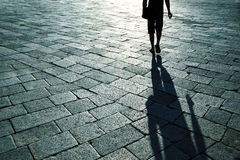 Shadow of single man on street Stock Photo