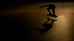Skateboarder at night royalty free stock image