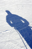 Shadow on the snow. Shadow of a skier stood on the piste Royalty Free Stock Image