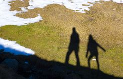 Shadow of some walkers projected on the floor of a mountain in the Pyrenees. Shadow of some walkers projected on the floor of a mountain in the French Pyrenees royalty free stock photo