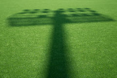 Shadow of stadium light on the grass Royalty Free Stock Image