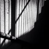 Shadow of a staircase banister Stock Photos