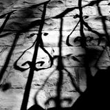Shadow of a staircase banister Stock Photo